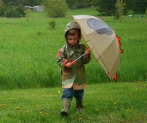 Boy mit seinem Regenschirm und Jacke regen unter der Feder regen puzzle