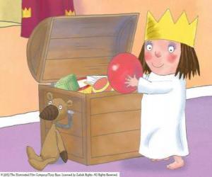Die kleine Prinzessin mit ihrem Spielzeug puzzle