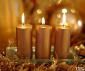 Drei goldene Weihnachtskerzen puzzle