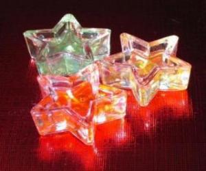 Drei kleine Kerzen in einem Stern puzzle