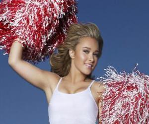Eine Cheerleaderin mit Bommel während der Show puzzle