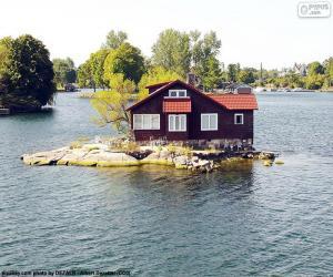 Haus auf einer kleinen Insel puzzle