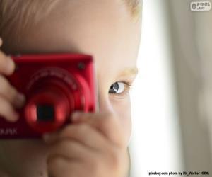 Kind mit Fotokamera puzzle