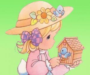 Mädchen mit einem Vogel. Precious Moments puzzle