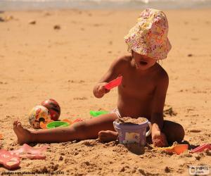 Mädchen spielen am Strand puzzle