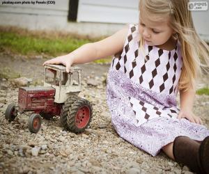 Mädchen spielt mit einem Traktor puzzle