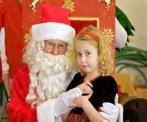 Mädchen im gespräch mit Weihnachtsmann sitzt auf dem schoß puzzle