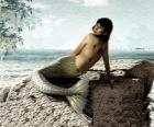 Sirene sitzen auf einem felsen am meer