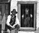 Alten sheriff mit cowboy-hut und stern auf der brust