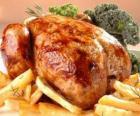 Geflügel gekochtes vollständiges zum ofen und mit der zutaten auf einen behälter