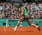 Tennis Spiel mit Zuschauer auf der Tribüne