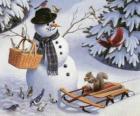 Schneemann mit einem Eichhörnchen und verschiedene Vögel herum