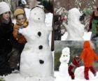 Kinder spielen mit Schneemann