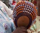 Die Shékere oder Chekere ist eine afrikanische Percussion-instrument