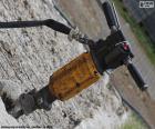 Ein Presslufthammer ist eine Maschine verwendet, um Pflaster, so dass große Löcher zu zerstören oder zu zerstören Bau