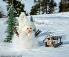 Schneemann und Schlitten