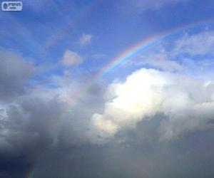 Regenbogen zwischen Wolken puzzle
