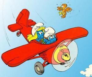 Smurf und Schlumpfine einem fliegenden roten Flugzeug puzzle