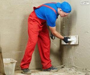 Stuckateur arbeitet an einer Wandverkleidung puzzle