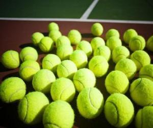 Tennisbälle auf dem Spielfeld puzzle