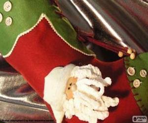 Weihnachten mit Santa's Gesicht und Knöpfen dekoriert Socke puzzle
