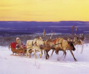 Weihnachts-Schlitten von Rentieren gezogen und mit Geschenken und Santa Claus geladen puzzle
