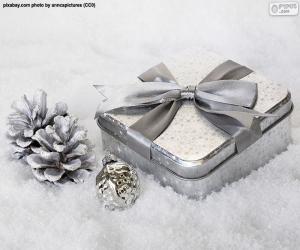 Weihnachtsgeschenk auf dem Schnee puzzle