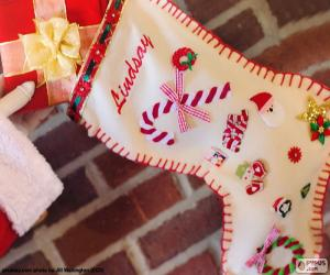 Weihnachtssocke und Geschenk puzzle